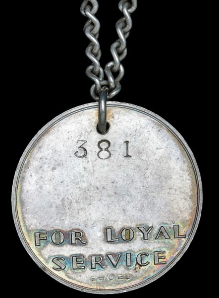 Territory of Papua and the Mandated Territory of New Guinea (Australian New Guinea Administrative Unit (ANGAU)) 1942-1945: Loyalty Medal for Papua & New Guinea, 1944. Reverse serial numbered '381'. With full neck chain, as-issued
